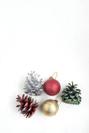 Christmas decoration with balls and cone on white