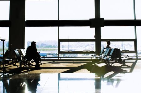silhouettes of passengers at the airport. travel concept