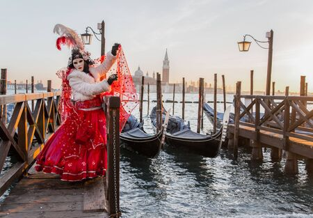 people in masks and costumes on Venetian carnival Stock Photo
