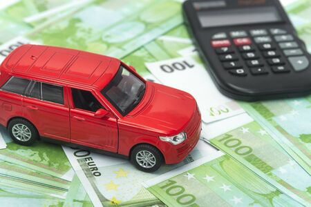 red car and money, euro and dollars. insurance concept Stock fotó