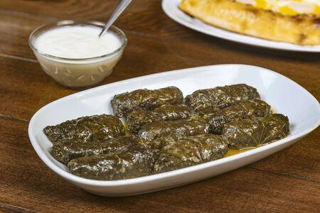 Dolma (tolma, sarma) - stuffed grape leaves with rice and meat.