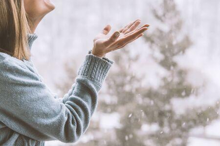 happy woman catching the snowflakes .winter photo Stock fotó
