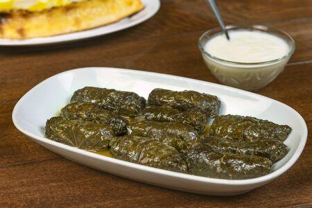 Dolma(tolma, sarma) - stuffed grape leaves with rice and meat. Armenian ,georgian or greek dolmades .Traditional Caucasian, Ottoman, Turkish and Greek cuisine.. Stock fotó