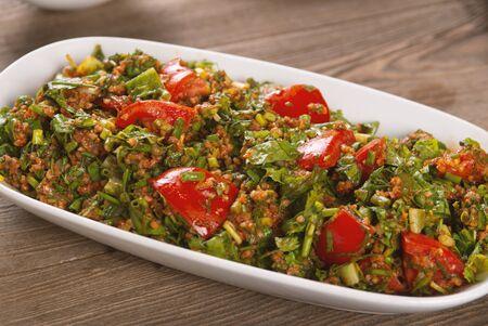 oriental tabbouleh salad on a wooden table Stock fotó
