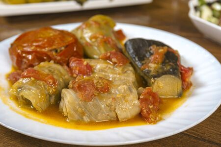 Dolma with cabbage, eggplant, tomatoes and pepper. Cabbage rolls with meat, rice and vegetables.Traditional Caucasian, Ottoman, Turkish cuisine. Stock fotó