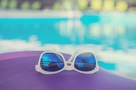 summer vacation concept. sunny day near open air pool Archivio Fotografico - 138084704
