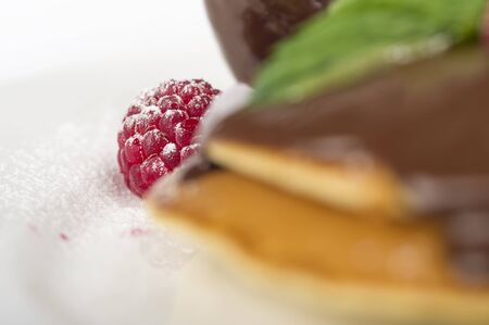 stack of pancakes with chocolate sauce.pancake with chocolate and raspberries in white background