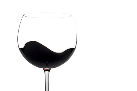 Moving red wine glass over a white