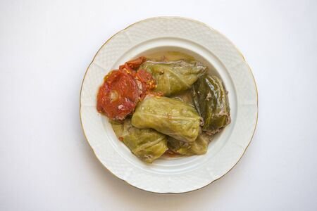 Cabbage leaves stuffed with meat on white