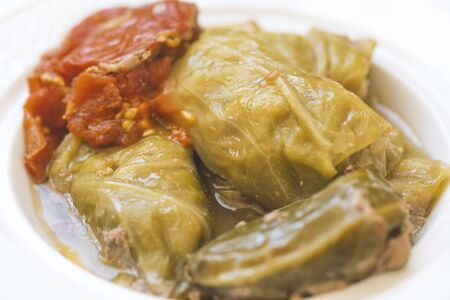 Cabbage leaves stuffed with meat in a white plate Standard-Bild