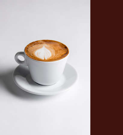 Latte coffee in white coffee cup with plate on white background. cappuccino coffee