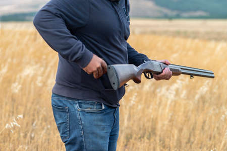 Male hunter ready to hunt with hunting rifle.hunter Holds a rifle.