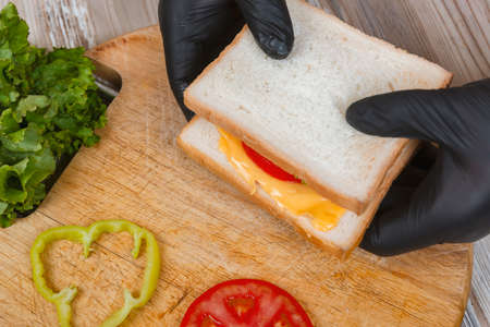 Process of cooking sandwich. variety of fillings and ingredients.Homemade Fast Food concept Zdjęcie Seryjne