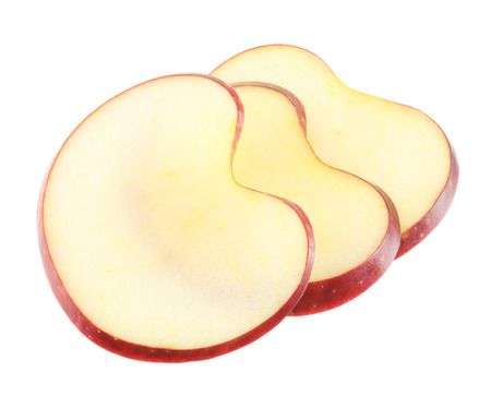 Heart shaped apple slices on a white background
