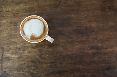 Coffee cup on the wooden table photo