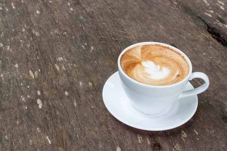 capucinno: Coffee cup on the wooden table Stock Photo