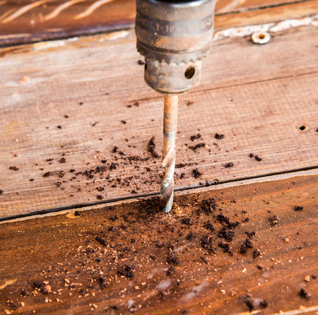 electrics: Electrics hand Drill drilling wood board
