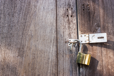 old wooden door: golden lock on the old wooden door Stock Photo