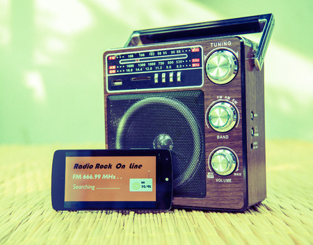 concept of difference technology ,picture of smart phone playing online radio and radio receiver , vintage style