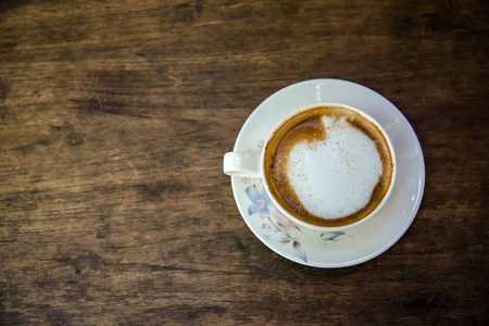 morning coffee: white coffee cup on the wooden table