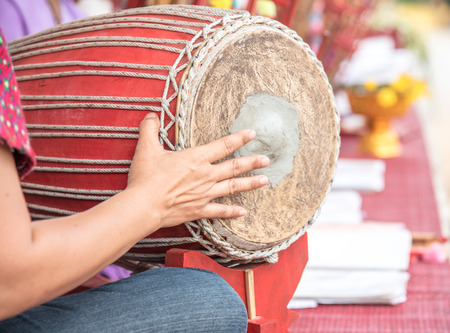 cow skin: Thai Drum and drummer hand playing music, Traditional  drum made from wood and cow skin.