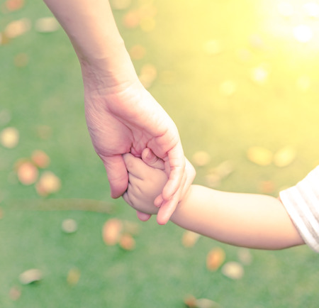 family with one child: Family scene , closeup parent and baby holding hand together Stock Photo