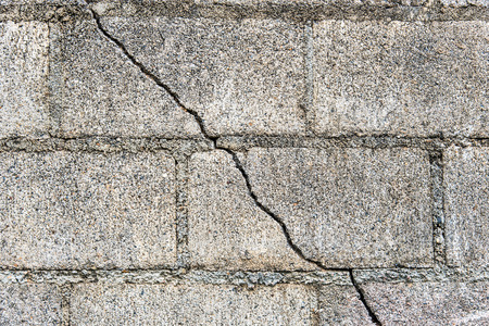 cracked cement: cracked cement block wall Stock Photo