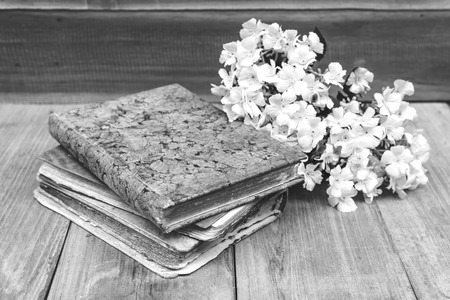 old diary: black and white ,old diary book put on the wood floor together with flower