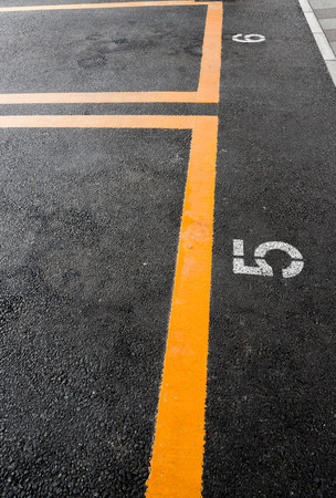 car parking: Parking lot with yellow line and slot number