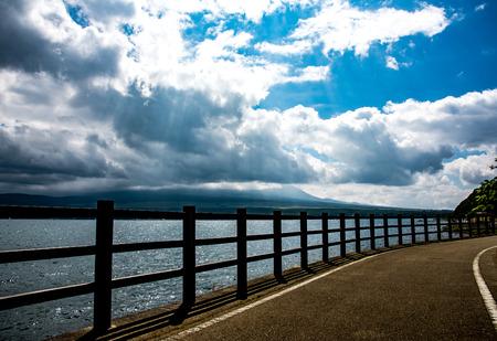 Fence beside lake below Fuji mountain