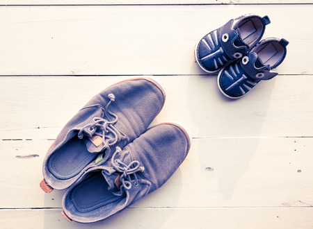 baby shoe: top view of father and baby shoe put together Stock Photo