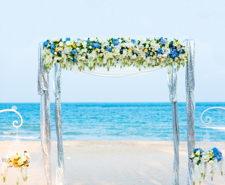 serine: wedding ceremony on the shore of the ocean sea arch on the beach.
