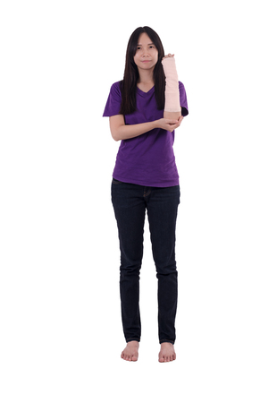 Asian lady in purple T shirt wearing  elastic bandage on her arm.