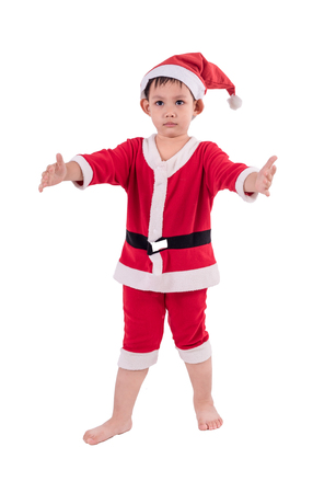 Asian kid dress up as santa claus. Isolated with clipping path Stock Photo