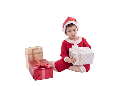 Asian kid dress up as santa claus with gift boxes .  Isolated with clipping path