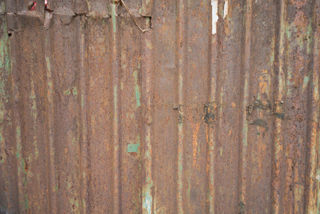 decomposed: Texture of rusty old metal piece shows detail and worn sign