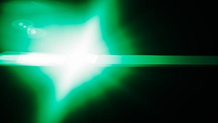 Realistic Len flare glow light effect on black background. Optical flares overlay or screen filter matte. Banco de Imagens - 120892680