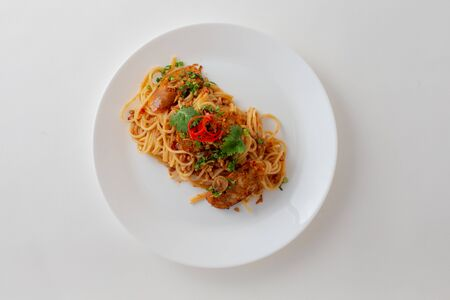 Material of Spicy Spaghetti with Thai sausage isolaed whie Background.