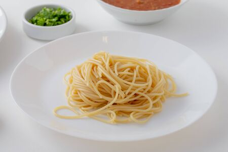 Material of Spicy Spaghetti with Thai sausage isolaed whie Background. Reklamní fotografie