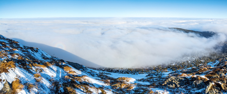 spectre: From the lawn covered with stones opens a landscape with fog and mysterious Brocken Spectre on the winter day.