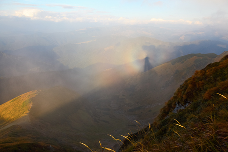 A unique phenomenon in nature: Brocken Spectre  in the Carpathian Mountains on foggy day.
