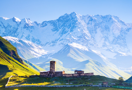 A fascinating view on Ushguli village at the foot of snow-capped Mt. Shkhara. Location place Lamaria Church Jgrag, Upper Svaneti, Georgia, Europe. Happy lifestyle. Beautiful universe.