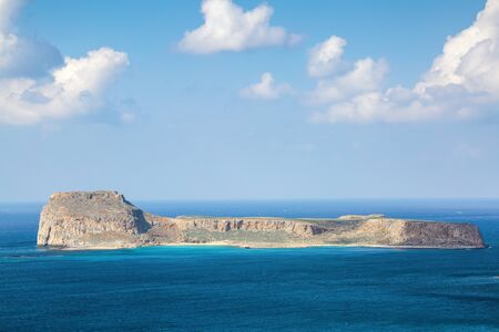 Mysterious Balos bay, island Crete, Greece. In the azure sea there are mountains edged with the water. Sky with clouds. Waves. Landscape in sunny day. Archivio Fotografico - 128367197