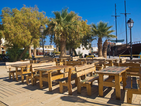 wooden tables and benches on the street Rethymno Crete