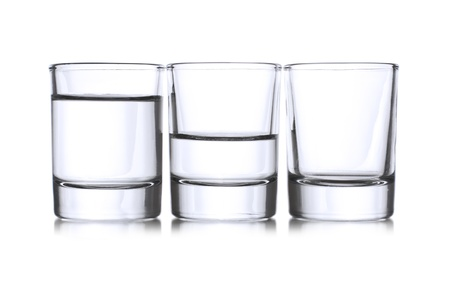 empty: Three shots with vodka,full,half,empty Stock Photo