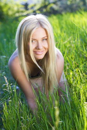 blonde females: Playful blond on the lawn Stock Photo