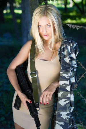 Gorgeous blond is fond of military style Stock Photo - 11073431