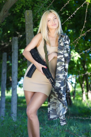 erotic dress: Sexy smiling soldier Stock Photo