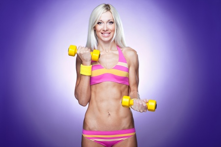 Sexy blond excercising photo