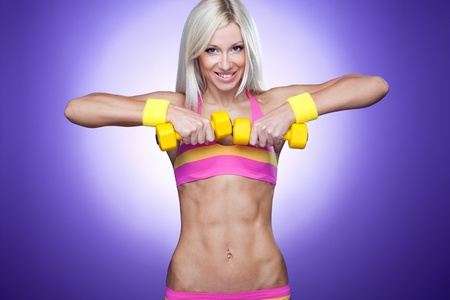 Bright image of a blond with dumb-bells photo
